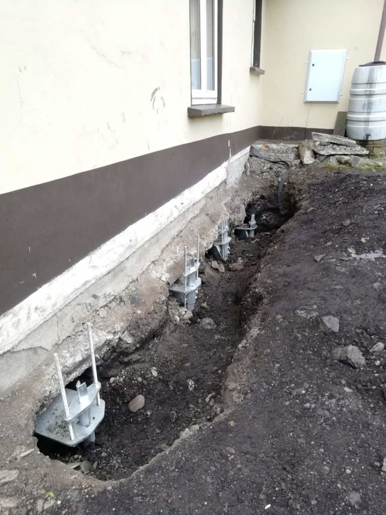 Building with underpinning complete using screw piles foundation screws ireland