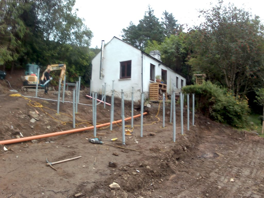 Foundation screws stabilise a slope to allow a foundation pour
